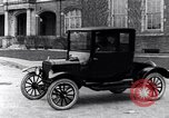 Image of Various Ford Model-T cars United States USA, 1917, second 2 stock footage video 65675031032