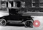 Image of Various Ford Model-T cars United States USA, 1917, second 26 stock footage video 65675031032