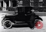 Image of Various Ford Model-T cars United States USA, 1917, second 30 stock footage video 65675031032