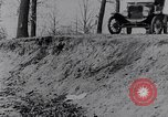 Image of Ford Model-T on rough roads United States USA, 1917, second 19 stock footage video 65675031035