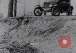 Image of Ford Model-T on rough roads United States USA, 1917, second 20 stock footage video 65675031035