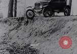 Image of Ford Model-T on rough roads United States USA, 1917, second 21 stock footage video 65675031035