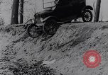 Image of Ford Model-T on rough roads United States USA, 1917, second 22 stock footage video 65675031035