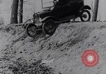 Image of Ford Model-T on rough roads United States USA, 1917, second 23 stock footage video 65675031035