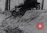 Image of Ford Model-T on rough roads United States USA, 1917, second 24 stock footage video 65675031035