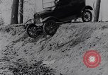 Image of Ford Model-T on rough roads United States USA, 1917, second 25 stock footage video 65675031035