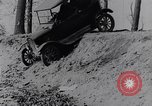 Image of Ford Model-T on rough roads United States USA, 1917, second 26 stock footage video 65675031035