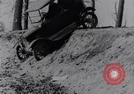 Image of Ford Model-T on rough roads United States USA, 1917, second 27 stock footage video 65675031035