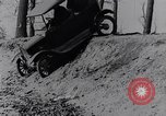 Image of Ford Model-T on rough roads United States USA, 1917, second 28 stock footage video 65675031035