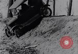 Image of Ford Model-T on rough roads United States USA, 1917, second 29 stock footage video 65675031035