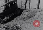 Image of Ford Model-T on rough roads United States USA, 1917, second 31 stock footage video 65675031035