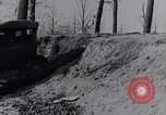 Image of Ford Model-T on rough roads United States USA, 1917, second 32 stock footage video 65675031035