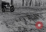 Image of Ford Model-T on rough roads United States USA, 1917, second 36 stock footage video 65675031035