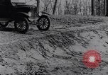 Image of Ford Model-T on rough roads United States USA, 1917, second 37 stock footage video 65675031035