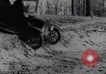 Image of Ford Model-T on rough roads United States USA, 1917, second 38 stock footage video 65675031035