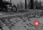 Image of Ford Model-T on rough roads United States USA, 1917, second 45 stock footage video 65675031035