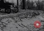 Image of Ford Model-T on rough roads United States USA, 1917, second 46 stock footage video 65675031035