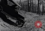 Image of Ford Model-T on rough roads United States USA, 1917, second 49 stock footage video 65675031035