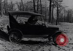 Image of Ford Model-T on rough roads United States USA, 1917, second 50 stock footage video 65675031035