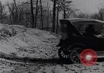 Image of Ford Model-T on rough roads United States USA, 1917, second 51 stock footage video 65675031035