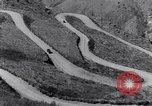 Image of Ford cars travel mountain roads United States USA, 1917, second 15 stock footage video 65675031041