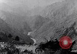 Image of Ford cars travel mountain roads United States USA, 1917, second 38 stock footage video 65675031041