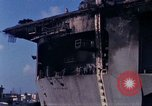 Image of USS Enterprise docked after fire Pearl Harbor Hawaii USA, 1969, second 2 stock footage video 65675031057
