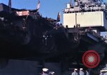 Image of USS Enterprise docked after fire Pearl Harbor Hawaii USA, 1969, second 31 stock footage video 65675031057