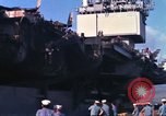Image of USS Enterprise docked after fire Pearl Harbor Hawaii USA, 1969, second 33 stock footage video 65675031057