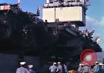 Image of USS Enterprise docked after fire Pearl Harbor Hawaii USA, 1969, second 34 stock footage video 65675031057