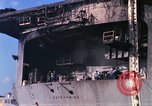 Image of USS Enterprise docked after fire Pearl Harbor Hawaii USA, 1969, second 45 stock footage video 65675031057