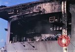 Image of USS Enterprise docked after fire Pearl Harbor Hawaii USA, 1969, second 46 stock footage video 65675031057