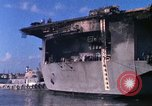 Image of USS Enterprise docked after fire Pearl Harbor Hawaii USA, 1969, second 54 stock footage video 65675031057