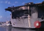 Image of USS Enterprise docked after fire Pearl Harbor Hawaii USA, 1969, second 58 stock footage video 65675031057