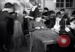 Image of Jewish refugees learn sewing Paris France, 1938, second 15 stock footage video 65675031081