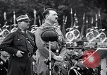 Image of Adolf Hitler reviews brown shirts Germany, 1933, second 12 stock footage video 65675031413