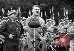 Image of Adolf Hitler reviews brown shirts Germany, 1933, second 18 stock footage video 65675031413