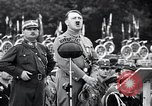 Image of Adolf Hitler reviews brown shirts Germany, 1933, second 21 stock footage video 65675031413