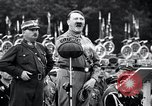Image of Adolf Hitler reviews brown shirts Germany, 1933, second 26 stock footage video 65675031413