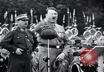 Image of Adolf Hitler reviews brown shirts Germany, 1933, second 32 stock footage video 65675031413
