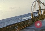 Image of Oceanic survey vessel in heavy seas Pacific ocean, 1963, second 19 stock footage video 65675031521