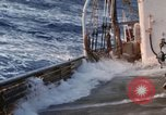 Image of Oceanic survey vessel in heavy seas Pacific ocean, 1963, second 21 stock footage video 65675031521