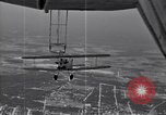 Image of N2Y-1 training plane hooks onto and is hoisted aboard USS Akron United States USA, 1932, second 14 stock footage video 65675031703