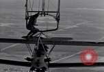 Image of N2Y-1 training plane hooks onto and is hoisted aboard USS Akron United States USA, 1932, second 38 stock footage video 65675031703