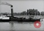 Image of traffic on Rhine Wiesbaden Germany, 1954, second 36 stock footage video 65675031783