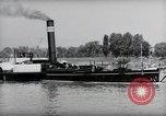 Image of traffic on Rhine Wiesbaden Germany, 1954, second 37 stock footage video 65675031783