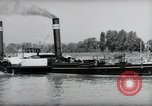 Image of traffic on Rhine Wiesbaden Germany, 1954, second 38 stock footage video 65675031783