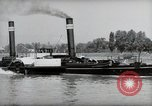 Image of traffic on Rhine Wiesbaden Germany, 1954, second 39 stock footage video 65675031783