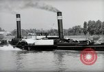 Image of traffic on Rhine Wiesbaden Germany, 1954, second 40 stock footage video 65675031783