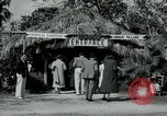 Image of tourists at Seminole Native American Indian trading post Miami Florida USA, 1936, second 2 stock footage video 65675031908